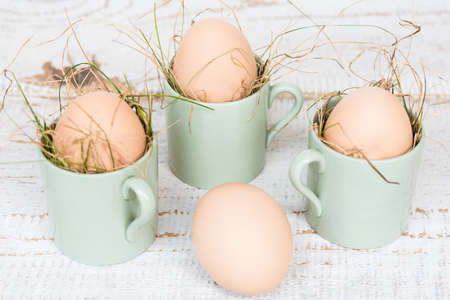 cup four: Four organic hen eggs, bio produce background