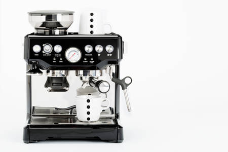 Isolated black manual coffee maker with coffee mugs on a white background, front view