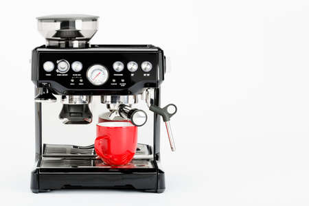 black appliances: Isolated black manual coffee maker with grinder and red coffee mug on a white background, front view