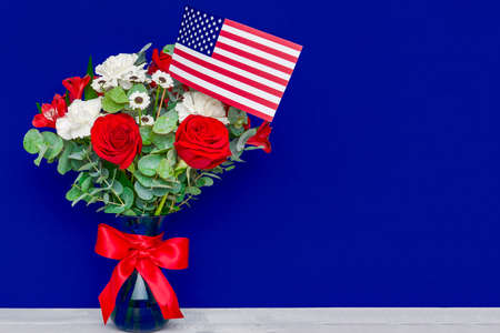 Beautiful bouquet with american flag on blue background