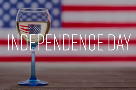 American flag and glass of white wine, 4th of July concept