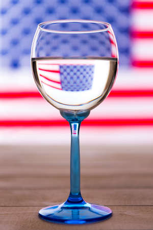 American flag and glass of white wine, party concept
