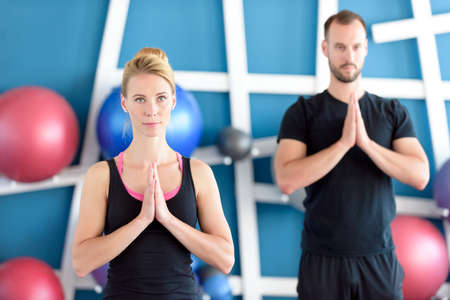 Young people in yoga class. Yoga group concept.