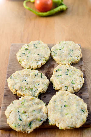Meat and zucchini burgers, bbq summer garden food concept