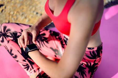 sportwoman: Close-up Shot. Female athlete using fitness app on her smart watch to monitor workout performance