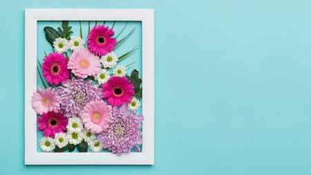 Picture frame filled with different gerberas and daisies. Happy Mother's Day, Women's Day, Valentine's Day or Birthday Pastel Candy Colors Background with copy space.