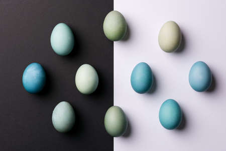 Happy Easter black and white background. Hand painted blue Easter eggs abstract minimal concept.