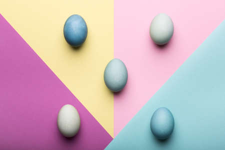 Happy Easter pastel coloured background. Hand painted Easter eggs abstract minimal concept.