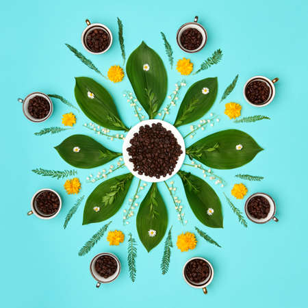 Creative coffee beans with flowers mandala pastel coloured art background. Good Morning Coffee floral setup concept.
