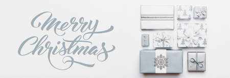 Christmas gifts banner. Beautiful nordic christmas presents isolated on white background. Pastel blue colored wrapped xmas boxes. Gift wrapping concept.