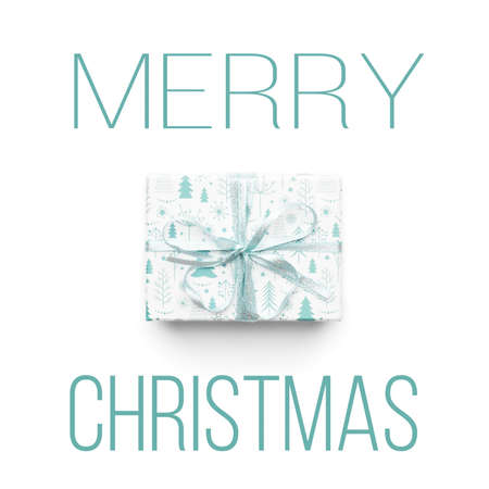 Beautiful christmas gift isolated on white background. Turquoise colored wrapped xmas box. Modern gift wrapping concept.