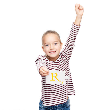 Cute young girl celebrating achievement at speech therapy. Child speech therapy concept isolated on white background. Hand in the air victory gesture. Stock Photo