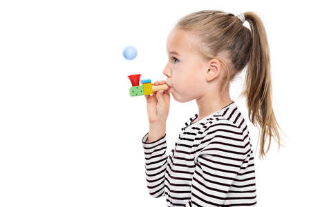 Cute young girl making special exercises at speech therapy office. Child speech therapy concept on white background. Speech impediment corrective exercises.