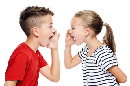 Young children facing eachother and shouting. Speech therapy concept over white background. 스톡 콘텐츠 - 112585632