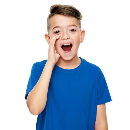 Cute boy in blue T-shirt shouting. Speech therapy concept over white background. Front view.