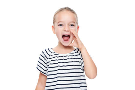 Cute little girl in stripped T-shirt shouting. Speech therapy concept over white background. Stock Photo