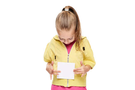 Young girl holding blank card infront of her. Speech therapy concept on white background. Correct pronounciation and articulation at preschool ag