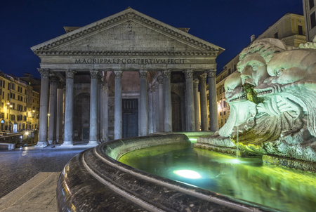 pantheon: Rome, Lazio, Italy. The Fountain of the Pantheon at night, on the background the Pantheon Editorial