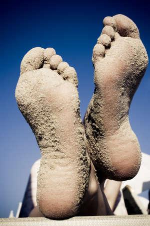 sandy feet: Girls sandy feet on beach in summer night Stock Photo