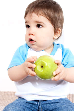 big apple: Cheerful baby with big apple in hands