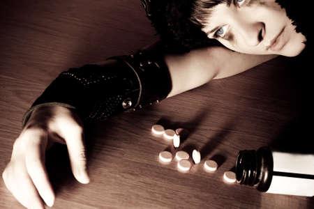 depressive: young depressive woman lying on floor
