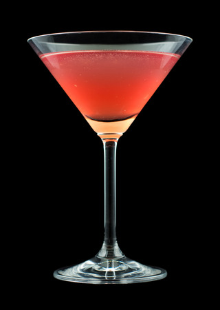 French Martini cocktail, consisting of vodka, raspberry liqueur and freshly squeezed pineapple juice. Isolated on black background