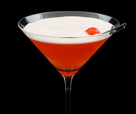 Mary Pickford cocktail, consisting of rum, maraschino liqueur, pineapple juice and grenadine, garnished with a maraschino cherry photo