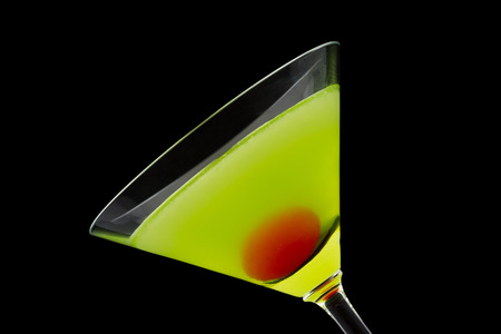 Japanese Slipper is a cocktail that contains melon liqueur, triple sec, freshly squeezed lemon juice and is garnished with a maraschino cherry Stock Photo