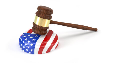 Judge gavel with American flag isolated on white photo