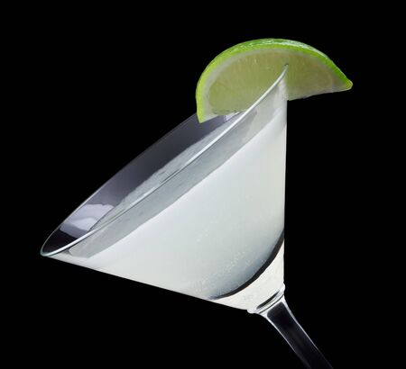 daiquiri: Daiquiri is a cocktail that contains light rum, fresh lime juice, simple syrup and is garnished with a lime wedge Stock Photo