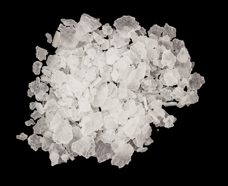 rock salt: Extreme closeup of salt isolated on a black background