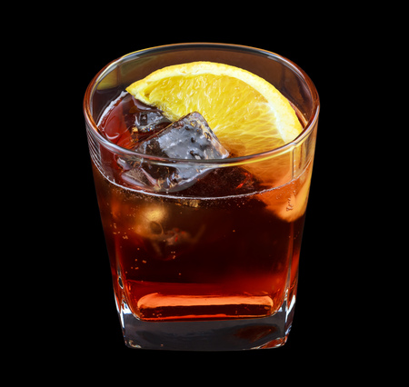 vermouth: Americano drink, consisting of sweet red vermouth, soda water. Isolated on black background Stock Photo