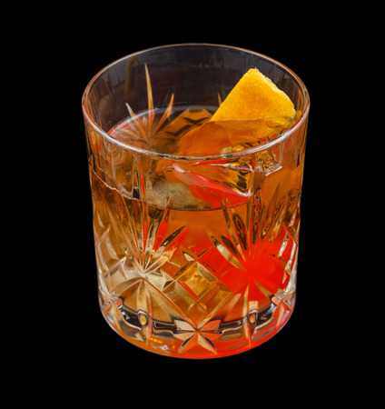 icecubes: Old Fashioned drink, consisting of bourbon, sugar cube, angostura bitters and soda water. Isolated on black background