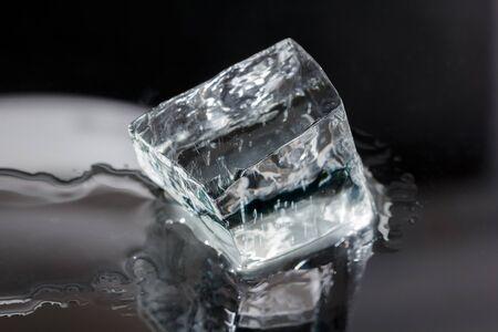 One big irregular shaped ice cube isolated on black Stock Photo