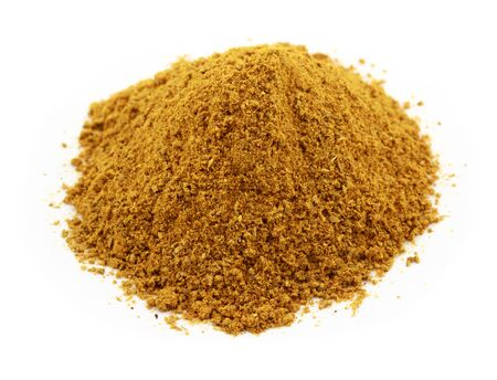 curry powder: A pile of curry powder isolated against a white background