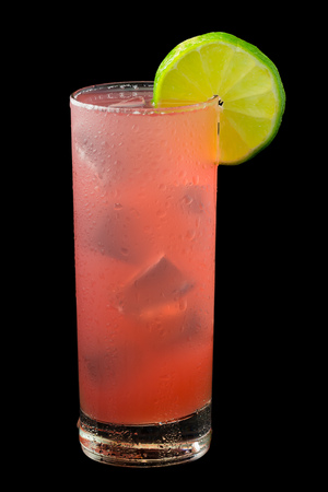 cranberry juice: Bay of Passion a pink drink that contains vodka cranberry juice pineapple juicepassion fruit liqueur and garnished with a slice of lime. Isolated on black.