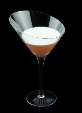 egg white: Clover Club is a classic cocktail that contains gin raspberry syrup lemon juice and a few drops of egg white. Isolated on black. Stock Photo