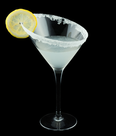 black rimmed: Lemon Drop Martini is a cocktail that contains vodka citron triple sec fresh lemon juice and is rimmed with sugar and garnished with a slice of lemon. Isolated on black.