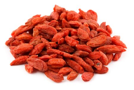 A pile of dried goji berries Lycium barbarum isolated on white