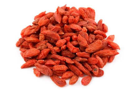 lycium: A pile of dried goji berries Lycium barbarum isolated on white