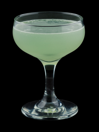 chartreuse: Green Ghost is a classic cocktail that contains gin, green chartreuse and lime juice. Isolated on black.