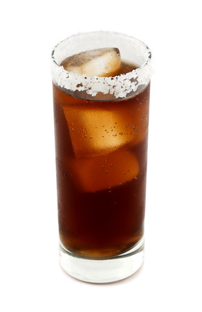 rimmed: Batanga is a Mexican drink that contains tequila and cola and is rimmed with salt. Isolated on white. Stock Photo