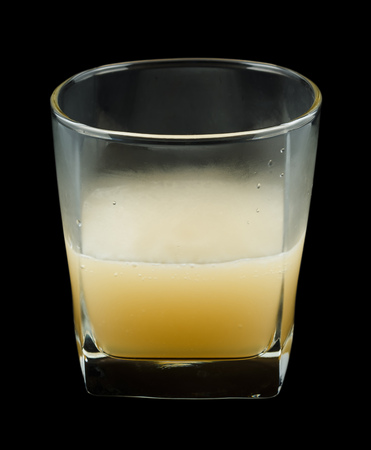benedictine: Bourbon Benedictine is a cocktail that contains bourbon whiskey, Benedictine, Cointreau and lemon juice. Isolated on black. Stock Photo