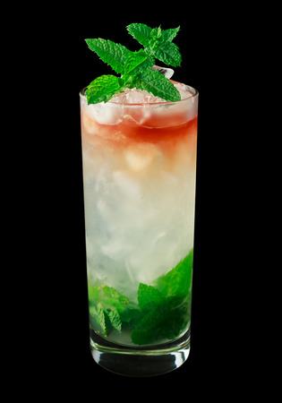 three layered: Queens Park Swizzle is a classic cocktail from the 1920s that contains rum, lime juice, mint, simple syrup, sugar and bitters. Isolated on black.