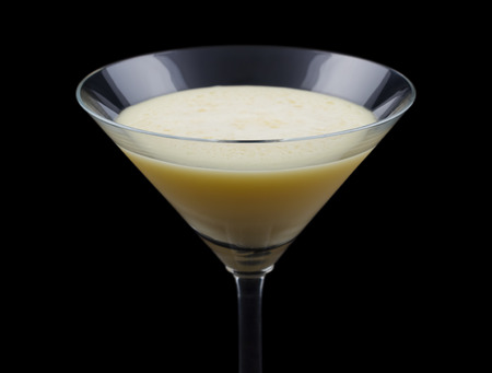 classed: Golden Dream is a cocktail that contains Galliano, Cointreau, fresh orange juice and fresh cream. It is classed as an after dinner drink. Isolated on black.