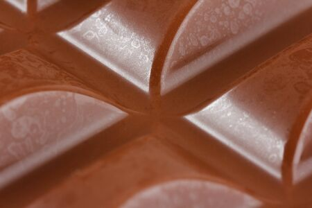 Close-up of milk chocolate filling up the whole frame