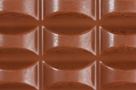 Close-up of milk chocolate from above filling up the whole frame Standard-Bild