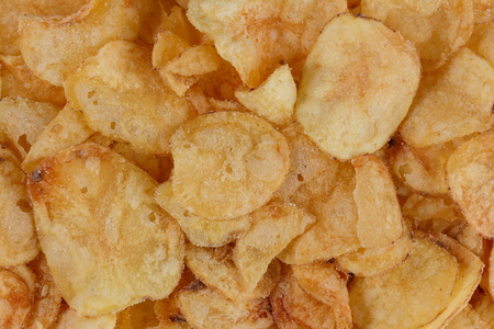 Top view of a big pile of potato chips