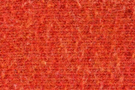 Close-up of red fabric from above filling up the whole frame