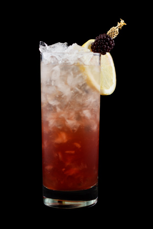 Russian spring break, consisting of vodka, lemon juice, creme de cassis, simple syrup and topped with sparkling wine. Isolated on black background.